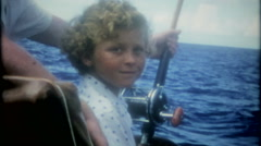 Family fun deep sea fishing on the ocean, 3625-vintage film home movie Stock Footage