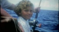 Family fun deep sea fishing on the ocean, 3625-vintage film home movie Stock Footage