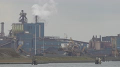 Steelworks industry with smoking chimneys,IJmuiden,Netherlands Stock Footage