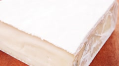 Gouda cheese on wooden table Stock Footage