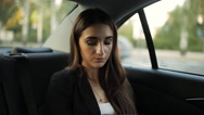 Businesswoman riding in a taxi to a business meeting, making a plan of Stock Footage