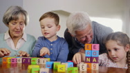 Grandparents playing with grandchildren Stock Footage
