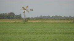 Small windmill in polder,Noord Holland,Netherlands Stock Footage