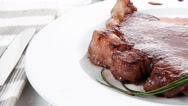 Juicy grilled beef meat steak fillet on white plate Stock Footage