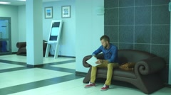 A man passes the documents to a colleague in the lobby of the office Stock Footage