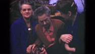 1946: two well-dressed women huddled closely around a third elderly woman ALASKA Stock Footage