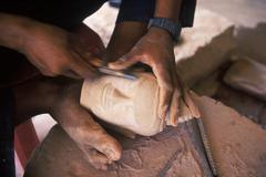 South East Asia, Cambodia, Siem Reap, artisan carves Buddha head for tourism Stock Photos
