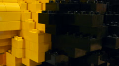 Large children's Lego yellow and black, close-up Stock Footage