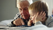 Grandfather and grandson with tablet Stock Footage