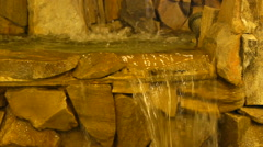 Decorative waterfall indoors, close-up, panorama from right to left Stock Footage