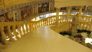 Someone down the parapet of the staircase inside the building, the museum Stock Footage