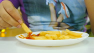 Guy eating fries in a public place, a cafe Stock Footage