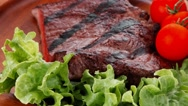 Dinner of fresh rich juicy grilled beef meat steak fillet with m Stock Footage