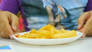 Guy starts to a meal, start eating fork french fries in a public place, cafe Stock Footage