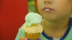 The little boy eats ice-cream, close-up Stock Footage