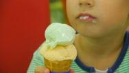 The little boy eats ice-cream, close-up Stock Footage