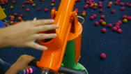 Adult and child charged air gun foam balls Stock Footage