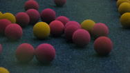Multi-colored foam balls to play air guns, close-up Stock Footage
