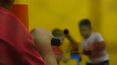 The two children's teams compete with each other in a shoot air guns, blur Stock Footage