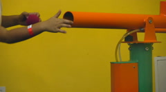 Boy charges the foam balls in the air gun and shoot out of it Stock Footage