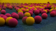 Multi-colored foam balls to play air guns lie on the floor, close-up Stock Footage