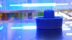 Blue Hockey bit for a game of air hockey, close-up Stock Footage
