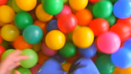 The child moves, cutting the legs colorful balls, a top view Stock Footage