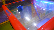 Blue Hockey bit air hockey lies on the surface of the gaming table Stock Footage