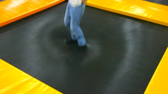 Children jumping on the trampoline, amusement park Stock Footage