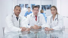 4K Medical team engaged in video call, seen from computer screen's pov Stock Footage