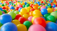 Someone goes on the colored ball in the children's play pool Stock Footage