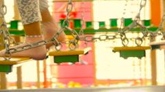 Children walking on hanging bridges in children's playgrounds, close-up Stock Footage
