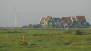 Traditional houses with modern windmills,Marken,Netherlands Stock Footage