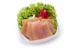 Cuttlefish slices with herbs and chili on white bowl Stock Photos