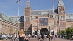 Cyclists cycling under Rijksmuseum tunnel,Amsterdam,Netherlands Stock Footage