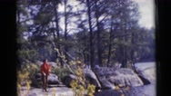 1953: windy day outside by the water's edge showing one person WISCONSIN Stock Footage