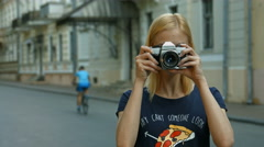 Young Girl Shooting on a Retro Camera Stock Footage