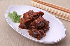Chinese style of deep fried chicken on white plate on bamboo tray Stock Photos