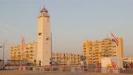 Lighthouse in beach town with road,Noordwijk aan Zee,Netherlands Stock Footage