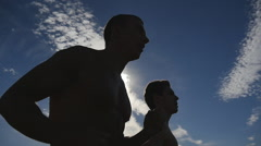 Two male jogger training for marathon run. Athletes exercising and running Stock Footage