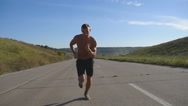 Sprinting runner man jogging at highway. Male athlete training. Slow motion Stock Footage