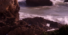 Sea water splashing at rocks Algarve Portugal Stock Footage