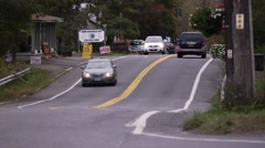 Cars travel on rural road in upstate New York Stock Footage