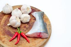 Pangasius or Vietnamese catfish in the kitchen in a white background Stock Photos