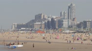 Tourists on beach with beachside hotels,Scheveningen,Netherlands Stock Footage
