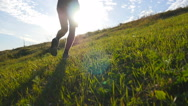 Male athlete is jogging in nature at sunset. Sports runner jogging outdoor Stock Footage