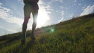 Male athlete is jogging in nature at sunset. Sports runner jogging uphill Stock Footage