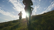 Male athletes is jogging in nature at sunset. Sport runners jogging outdoor Stock Footage
