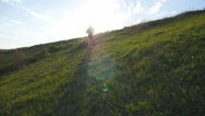 Sports runner jogging uphill outdoor at sunrise with flare. Slow motion Stock Footage