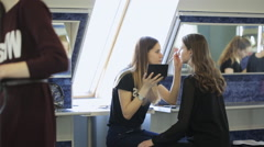 Young girls prepare for photoshoot in dressing room in day time Stock Footage